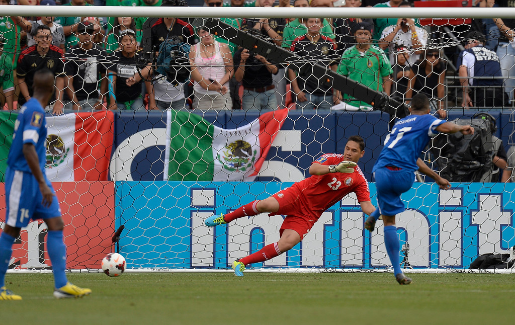 . Kevin Parsemain #17 of Martinique scores on a penalty kick in the first half as Goalkeeper Moises Munoz #22 watches the ball goes past him in the CONCACAF Gold Cup soccer game July 14, 2013 at Sports Authority Field at Mile High. (Photo By John Leyba/The Denver Post)
