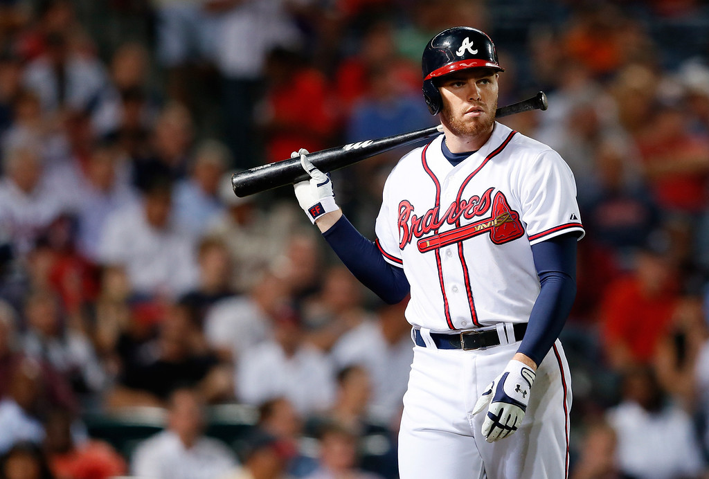 . ATLANTA, GA - OCTOBER 03: Freddie Freeman #5 of the Atlanta Braves walks to the dugout in the sixth inning against the Los Angeles Dodgers during Game One of the National League Division Series at Turner Field on October 3, 2013 in Atlanta, Georgia.  (Photo by Kevin C. Cox/Getty Images)