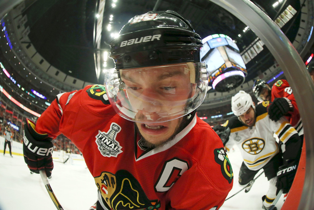 . Jonathan Toews #19 of the Chicago Blackhawks looks for the puck along the boards in the third period against the Boston Bruins in Game One of the NHL 2013 Stanley Cup Final at United Center on June 12, 2013 in Chicago, Illinois.  (Photo by Bruce Bennett/Getty Images)