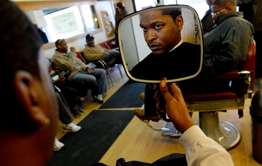 ". DENVER, CO. - DECEMBER 21: Joel Lewis looks at himself after a haircut from Marcus Pope at House of Hair in Denver, CO December 21, 2013. The shop will be relocating to 523 East 28th Ave and reopening on January 07, 2014. Owner Marcus Pope said, ""we didn\'t have a choice. The restaurant next door is expanding so they didn\'t renew our lease... I wasn\'t happy with the way it happened but I\'m looking forward to a new opportunity.\""  (Photo By Craig F. Walker / The Denver Post)"