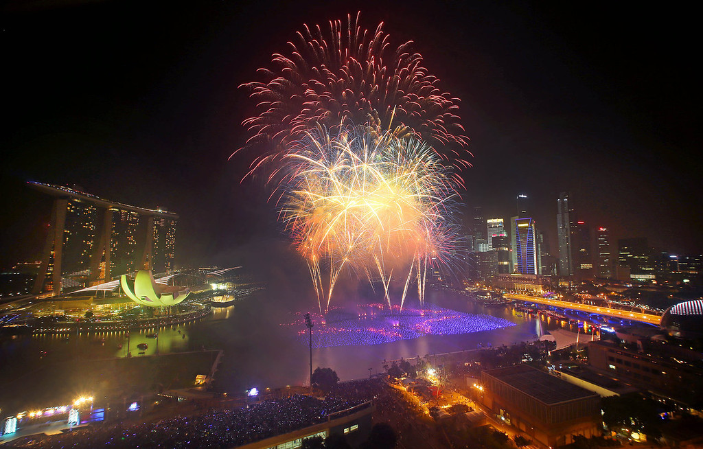 . Fireworks explode over the financial district at midnight, Wednesday, Jan. 1, 2014 in Singapore. Celebrations started on New Year\'s Eve where concerts were held and thousands gathered on the streets to usher in the Year 2014. (AP Photo/Wong Maye-E)
