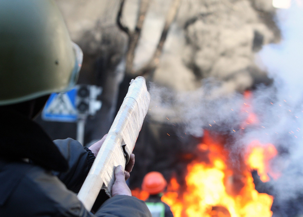 . A view of a smoking rifle on the streets of downtown Kiev, Ukraine, 18 February 2014. A least three protesters were killed in clashes with police on 18 February, Ukrainian opposition activists say.  EPA/IGOR KOVALENKO