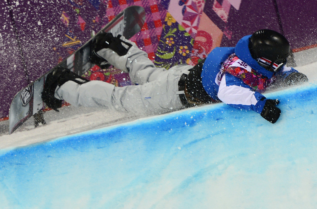. France\'s Johann Baisamy crashes in the Men\'s Snowboard Halfpipe Semifinals at the Rosa Khutor Extreme Park during the Sochi Winter Olympics on February 11, 2014.      AFP PHOTO / JAVIER SORIANO/AFP/Getty Images