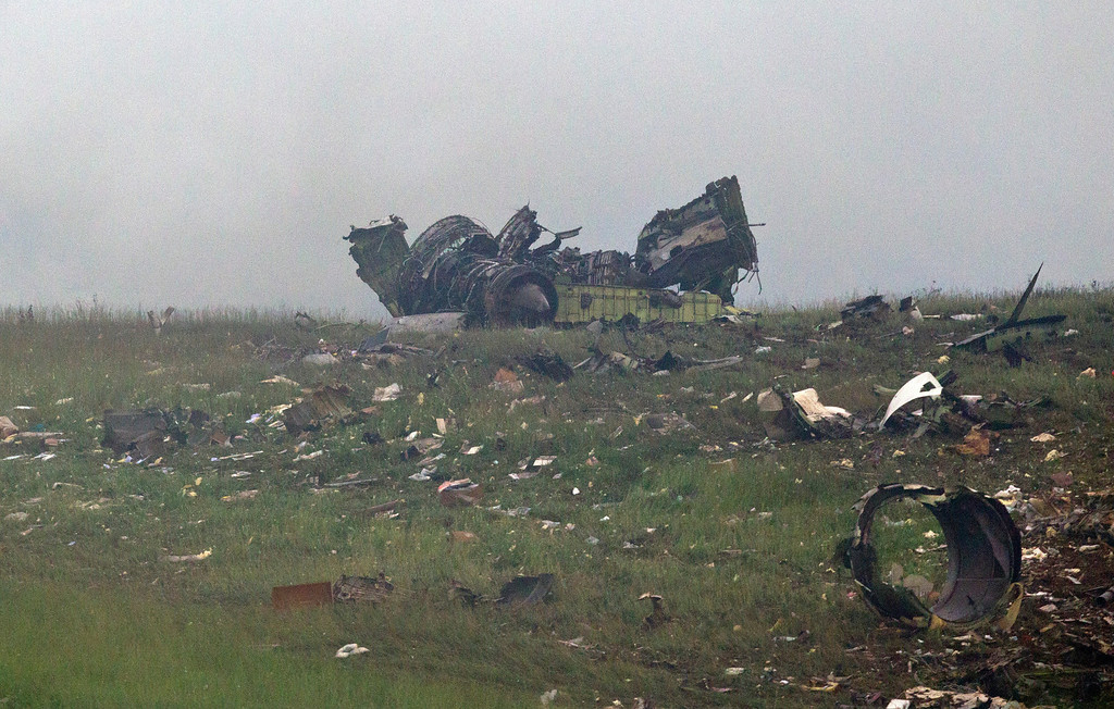 . Wreckage of a UPS cargo plane lies on a hill at Birmingham-Shuttlesworth International Airport after crashing on approach, Wednesday, Aug. 14,  2013, in Birmingham, Ala.  (AP Photo/Butch Dill)
