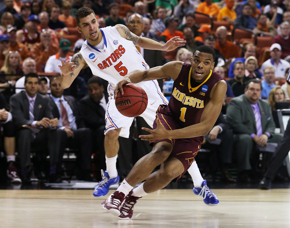 . Andre Hollins #1 of the Minnesota Golden Gophers drives past Scottie Wilbekin #5 of the Florida Gators in the second half during the third round of the 2013 NCAA Men\'s Basketball Tournament at The Frank Erwin Center on March 24, 2013 in Austin, Texas.  (Photo by Ronald Martinez/Getty Images)