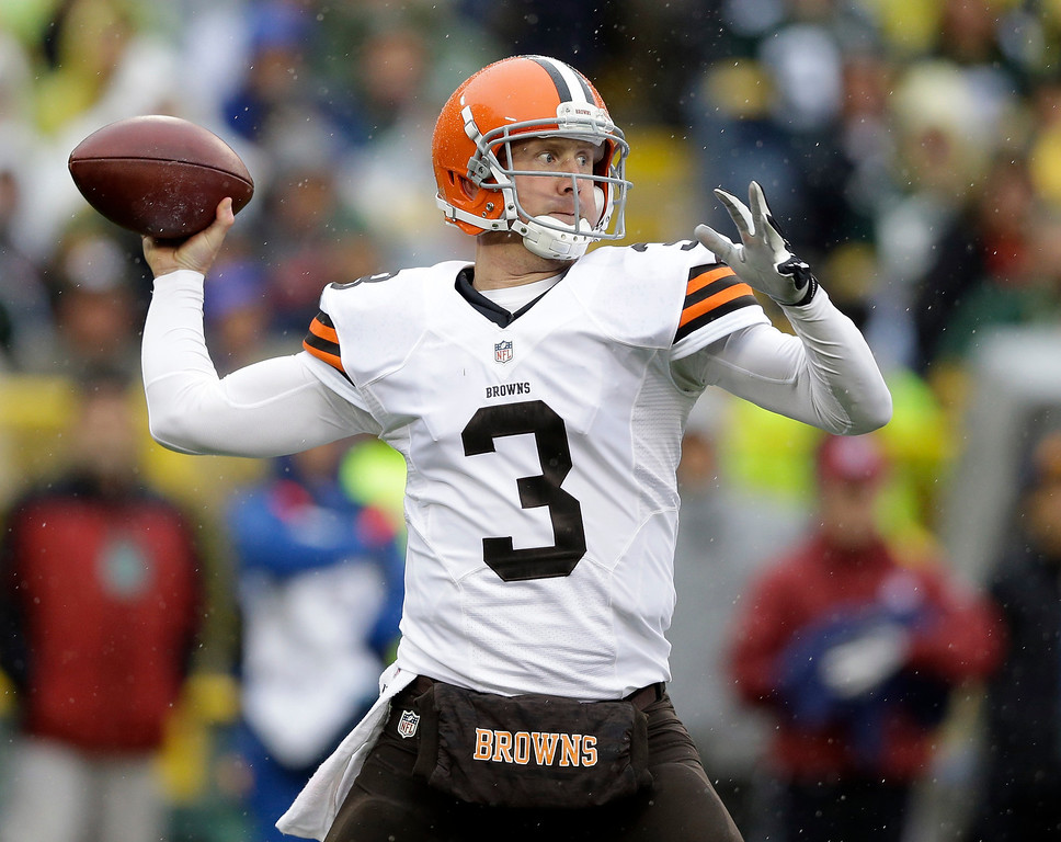 . Cleveland Browns quarterback Brandon Weeden throws before an NFL football game against the Green Bay Packers Sunday, Oct. 20, 2013, in Green Bay, Wis. (AP Photo/Tom Lynn)