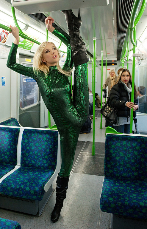 ". Contortionist ""Zlata\"" from Kazakhstan, poses on a London underground train during a photocall to promote the Erotica 2010 show, in west London on November 14, 2010. The Erotica show runs from 19-22 November 2010 and showcases the latest products available in the sex industry.       AFP PHOTO / LEON NEAL"