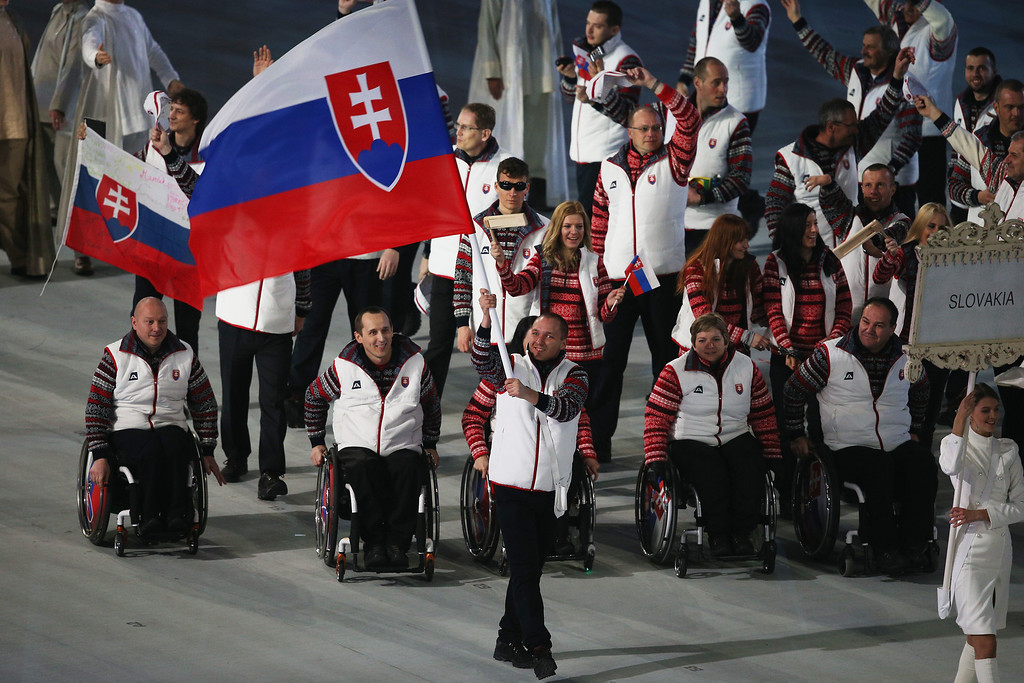 . Jakub Krako of Slovakia carries the flag during the Opening Ceremony of the Sochi 2014 Paralympic Winter Games at Fisht Olympic Stadium on March 7, 2014 in Sochi, Russia.  (Photo by Hannah Peters/Getty Images)