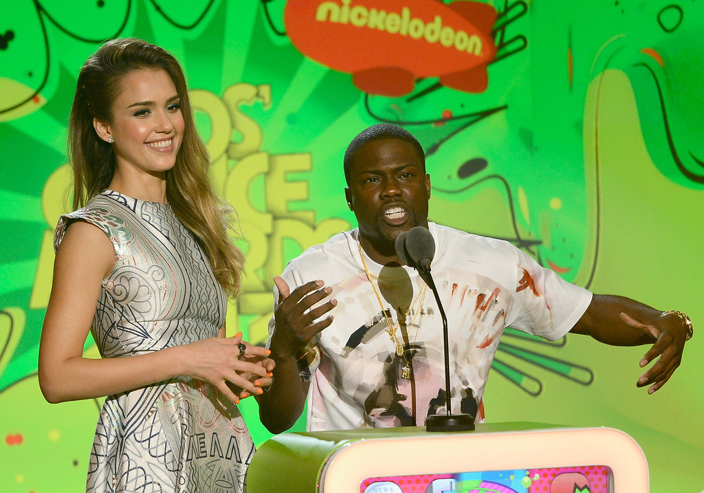 . LOS ANGELES, CA - MARCH 23:  Actors Jessica Alba and Kevin Hart speak onstage during Nickelodeon\'s 26th Annual Kids\' Choice Awards at USC Galen Center on March 23, 2013 in Los Angeles, California.  (Photo by Kevork Djansezian/Getty Images for KCA)