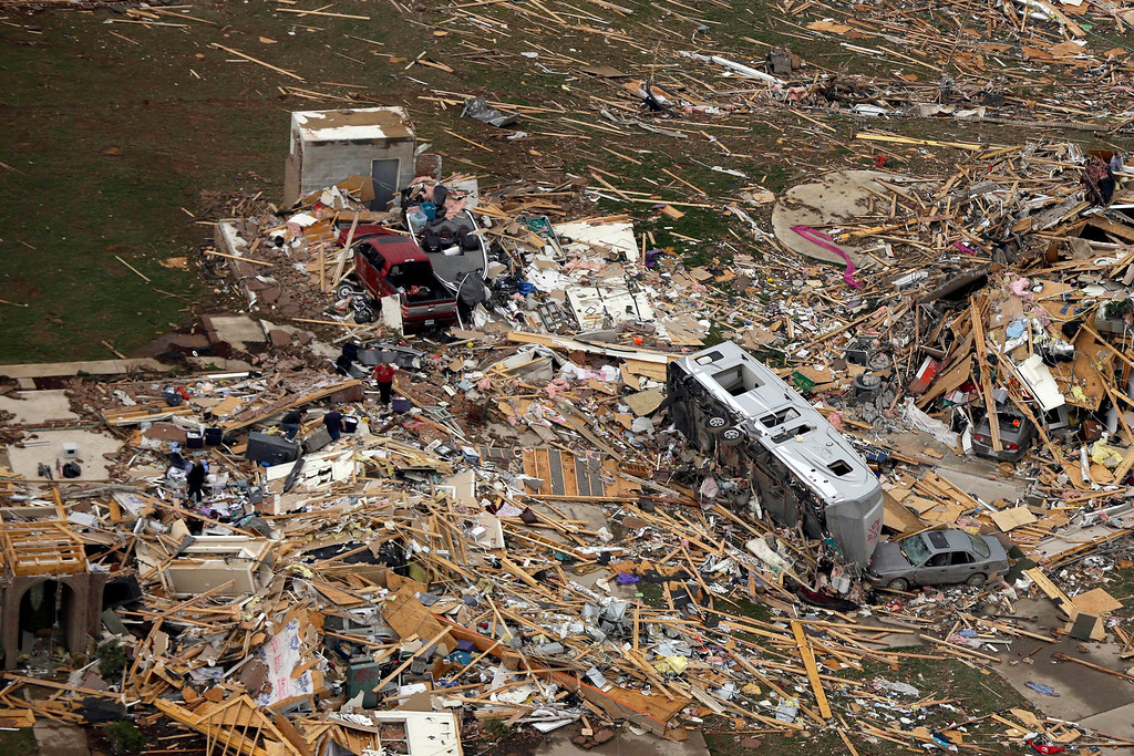 . A travel trailer sits inn the rubble of a house in Mayflower, Ark., Monday, April 28, 2014, after a tornado struck the town late Sunday.  (AP Photo/Danny Johnston)