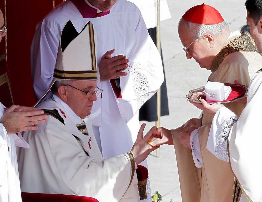 . The Fisherman\'s Ring is placed on the finger of Pope Francis by Cardinal Angelo Sodano (R), Dean of the College of Cardinals during his inaugural mass at the Vatican, March 19, 2013. Pope Francis celebrates his inaugural mass on Tuesday among political and religious leaders from around the world and amid a wave of hope for a renewal of the scandal-plagued Roman Catholic Church.                   REUTERS/Stefano Rellandini