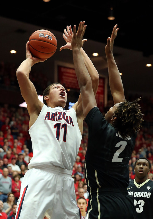 . Aaron Gordon #11 of the Arizona Wildcats attempts a shot against Xavier Johnson #2 of the Colorado Buffaloes during the first half of the college basketball game at McKale Center on January 23, 2014 in Tucson, Arizona.  (Photo by Christian Petersen/Getty Images)