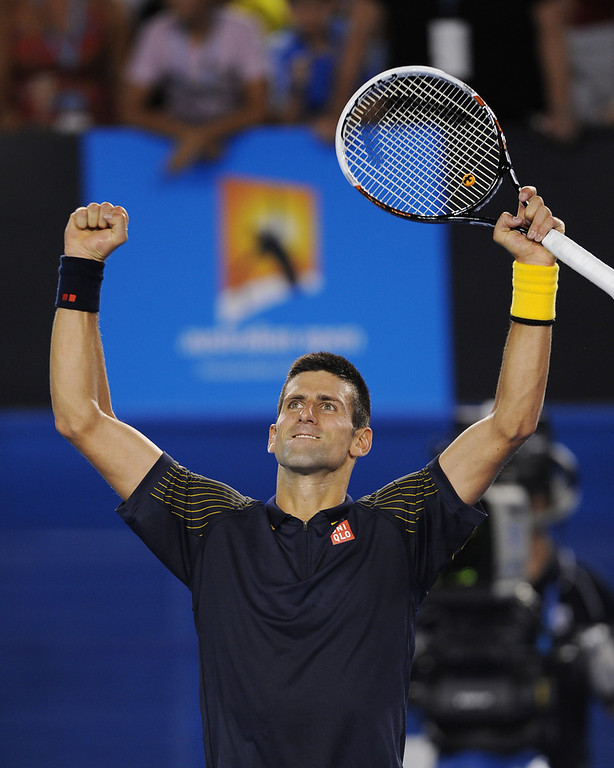 . Serbia\'s Novak Djokovic celebrates after defeating Spain\'s David Ferrer in their semifinal match at the Australian Open tennis championship in Melbourne, Australia, Thursday, Jan. 24, 2013. (AP Photo/Andrew Brownbill)