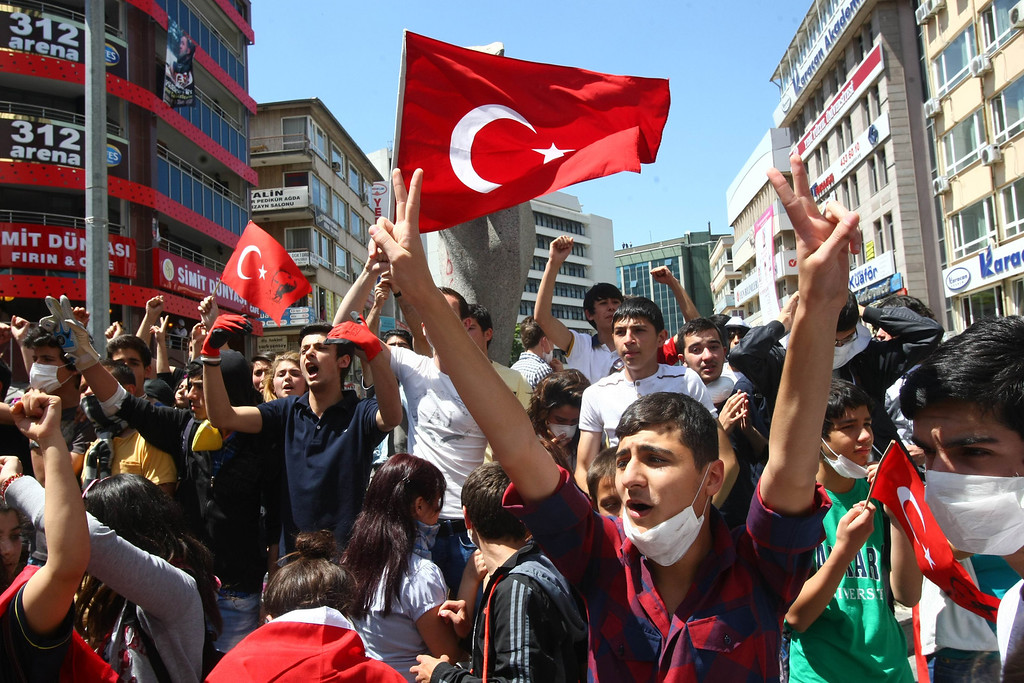 . Protesters shout anti-government slogans during a demonstration in Ankara on June 4, 2013.  AFP PHOTO / ADEM  ALTAN/AFP/Getty Images