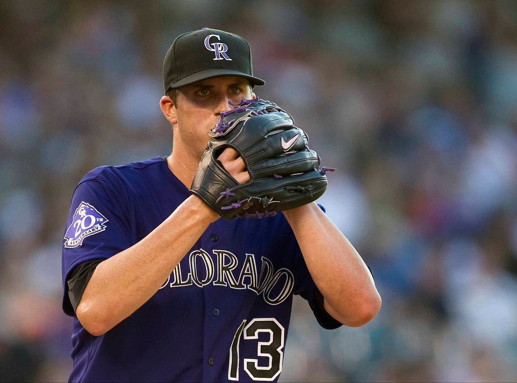 . Colorado Rockies\' #13 Drew Pomeranz takes a breath between pitches during the fourth inning of a Major League Baseball game against the Miami Marlins on July 22, 2013 at Coors Field in Denver. (Photo By Grant Hindsley/The Denver Post)