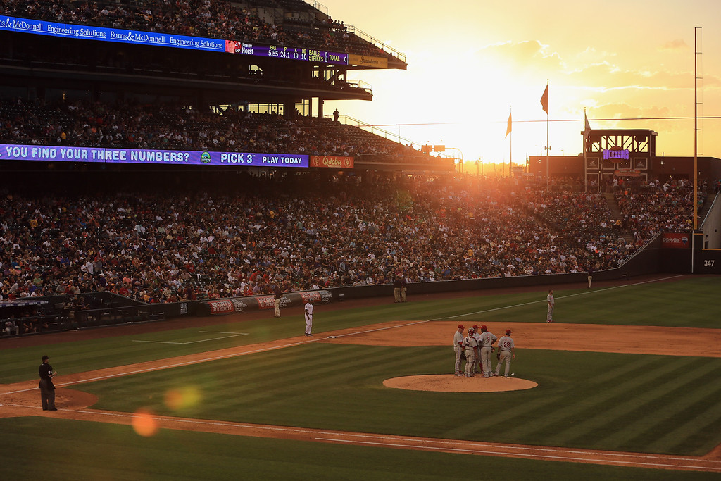 . DENVER, CO - JUNE 14:  The sun sets over the stadium as the Philadelphia Phillies face the Colorado Rockies at Coors Field on June 14, 2013 in Denver, Colorado.  (Photo by Doug Pensinger/Getty Images)