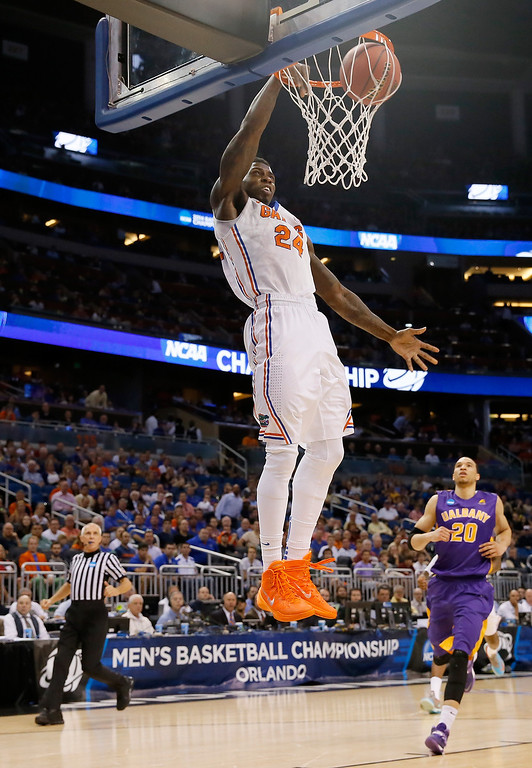 . ORLANDO, FL - MARCH 20:  Casey Prather #24 of the Florida Gators dunks the ball in the first half against the Albany Great Danes during the second round of the 2014 NCAA Men\'s Basketball Tournament at Amway Center on March 20, 2014 in Orlando, Florida.  (Photo by Kevin C. Cox/Getty Images)