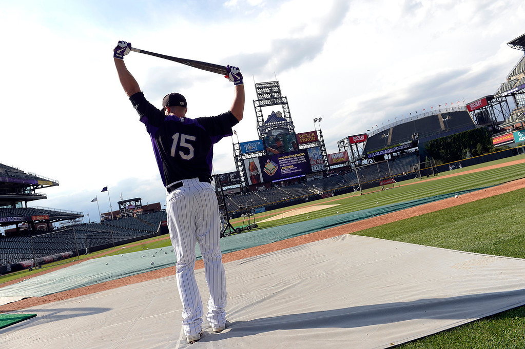 . Colorado Rockies Jordan Pacheco stretches before stepping in to the batting cage during an open workout session for the fans July 18, 2013 at Coors Field. (Photo By John Leyba/The Denver Post)