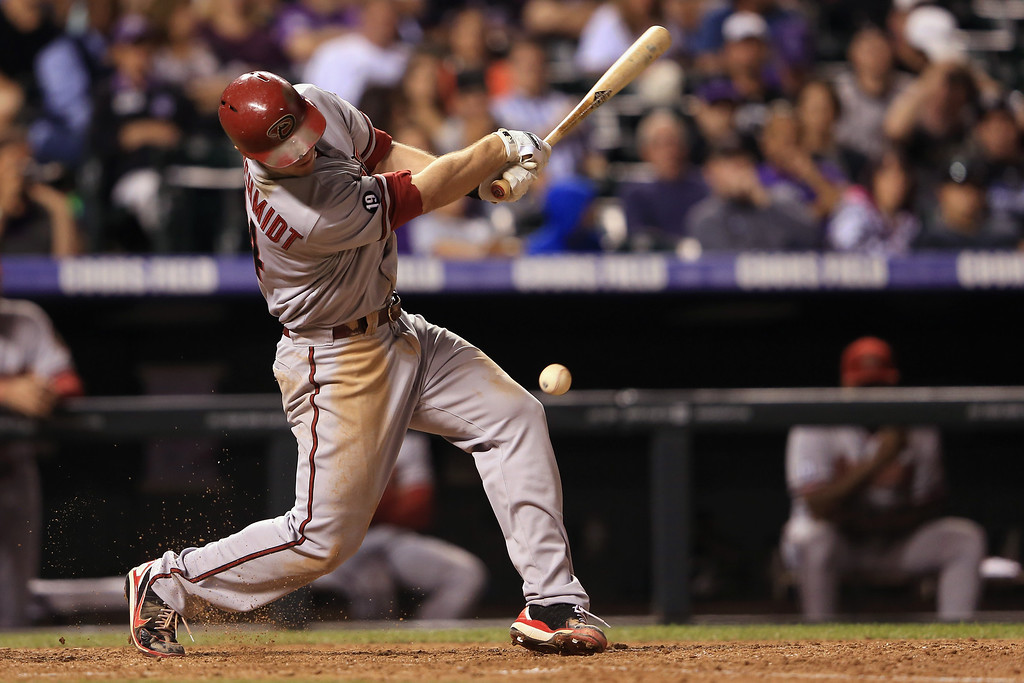 . DENVER, CO - SEPTEMBER 21:  Paul Goldschmidt #44 of the Arizona Diamondbacks hits a soft grounder for an RBI single to score Adam Eaton #6 of the Arizona Diamondbacks against the Colorado Rockies to take a 7-2 lead in the ninth inning at Coors Field on September 21, 2013 in Denver, Colorado.  (Photo by Doug Pensinger/Getty Images)