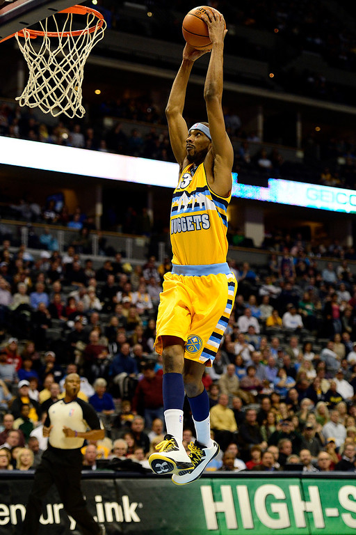 . Denver Nuggets small forward Corey Brewer (13) dunks against the Toronto Raptors during the first half at the Pepsi Center on Monday, December 3, 2012. AAron Ontiveroz, The Denver Post