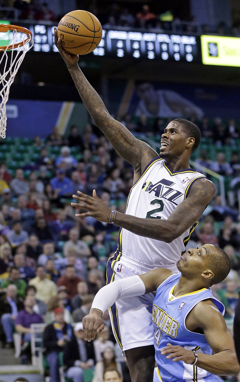 . Utah Jazz\'s Marvin Williams (2) goes to the basket as Denver Nuggets\' Randy Foye (4) defends in the first quarter during an NBA basketball game Monday, Jan. 13, 2014, in Salt Lake City. (AP Photo/Rick Bowmer)