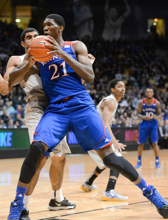 . Kansas center, Joel Embid, right, charges to the basket against Colorado forward, Josh Scott,left, in the first half of play at the Coors Events Center in Boulder Colorado Saturday afternoon, December 07, 2013. (Photo By Andy Cross/The Denver Post)