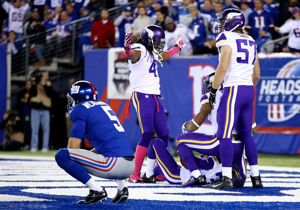. Strong safety Mistral Raymond #41 celebrates a first quarter touchdown by cornerback Marcus Sherels #35 of the Minnesota Vikings against the New York Giants during a game at MetLife Stadium on October 21, 2013 in East Rutherford, New Jersey.  (Photo by Al Bello/Getty Images)