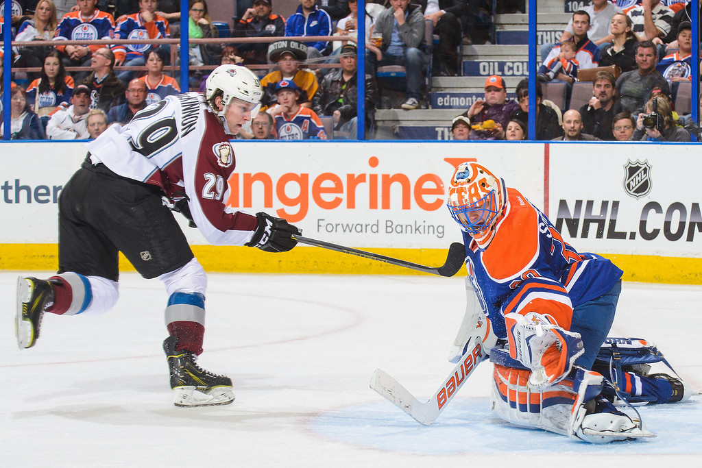 . Ben Scrivens #30 of the Edmonton Oilers stops the shot of Nathan MacKinnon #29 of the Colorado Avalanche during an NHL game at Rexall Place on April 8, 2014 in Edmonton, Alberta, Canada. The Avalanche defeated the Oilers 4-1. (Photo by Derek Leung/Getty Images)