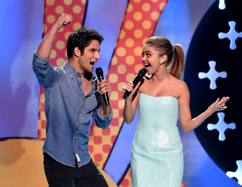 . Hosts Tyler Posey (L) and Sarah Hyland onstage during FOX\'s 2014 Teen Choice Awards at The Shrine Auditorium on August 10, 2014 in Los Angeles, California.  (Photo by Kevin Winter/Getty Images)