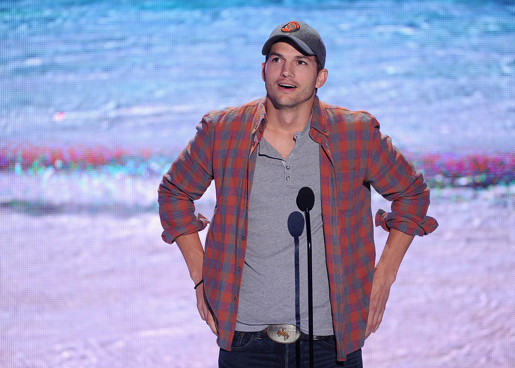 . Actor Ashton Kutcher speaks onstage during the Teen Choice Awards 2013 at Gibson Amphitheatre on August 11, 2013 in Universal City, California.  (Photo by Kevin Winter/Getty Images)