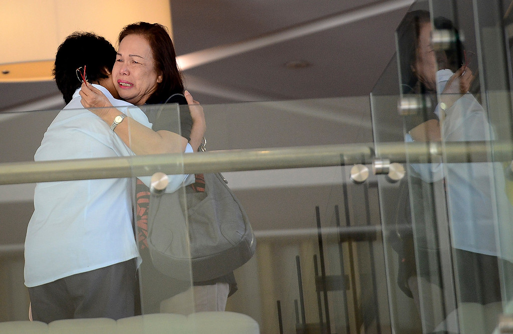 . Family members of passengers aboard a missing plane cry at a hotel in Putrajaya, Malaysia, Sunday, March 9, 2014. Military radar indicates that the missing Boeing 777 jet of Malaysia Airlines may have turned back, Malaysiaís air force chief said Sunday as scores of ships and aircraft from across Asia resumed a hunt for the plane and its 239 passengers. (AP Photo)