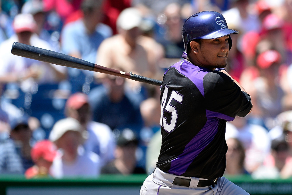 . Jhoulys Chacin #45 of the Colorado Rockies hits a RBI single in the fourth inning during a game against the Washington Nationals at Nationals Park on June 22, 2013 in Washington, DC. (Photo by Patrick McDermott/Getty Images)
