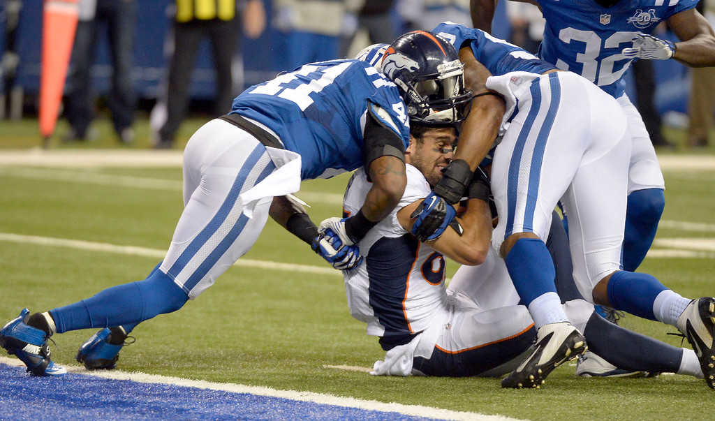 . INDIANAPOLIS, IN - OCTOBER 20: Denver Broncos wide receiver Eric Decker (87) gets crunched by Indianapolis Colts strong safety Antoine Bethea (41) and Indianapolis Colts inside linebacker Jerrell Freeman (50) at the one yard line during the fourth quarter October 20, 2013 at Lucas Oil Field. Photo by John Leyba/The Denver Post)