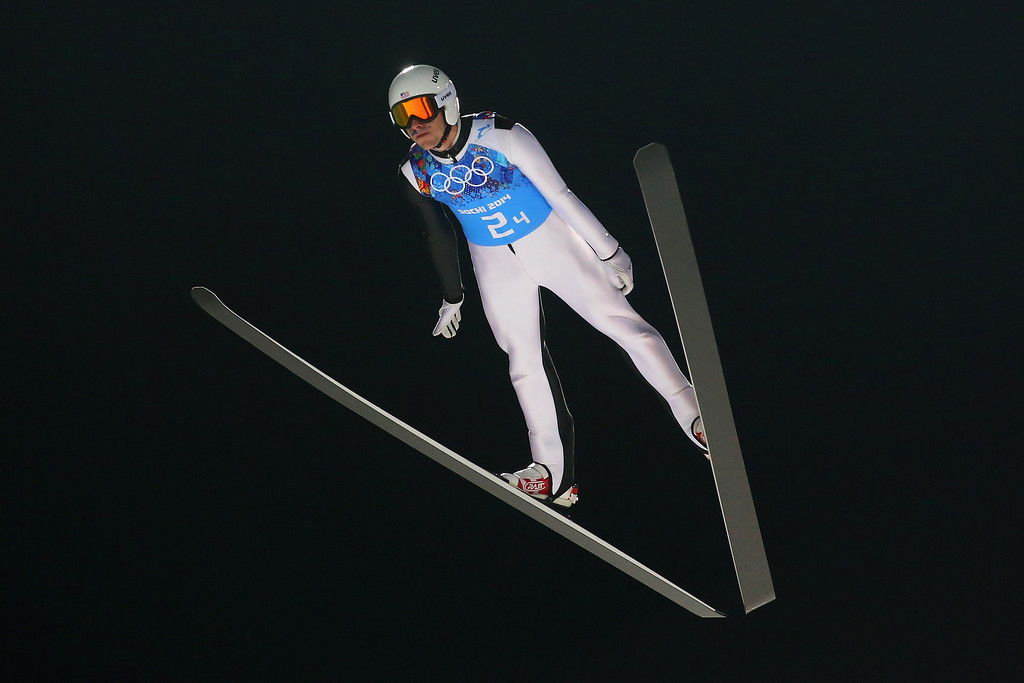 . Nicholas Alexander of the United States jumps during the Men\'s Team Ski Jumping first round on day 10 of the Sochi 2014 Winter Olympics at the RusSki Gorki Ski Jumping Center on February 17, 2014 in Sochi, Russia.  (Photo by Julian Finney/Getty Images)