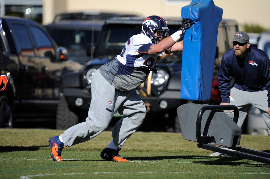 . Denver Broncos defensive end Derek Wolfe (95) hits the sled during practice November 13, 2013 at Dove Valley (Photo by John Leyba/The Denver Post)