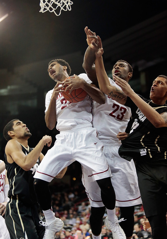 . Royce Woolridge #22 of the Washington State Cougars pulls in a rebound against the Colorado Buffaloes in the first half at Spokane Arena on January 8, 2014 in Spokane, Washington.  (Photo by William Mancebo/Getty Images)