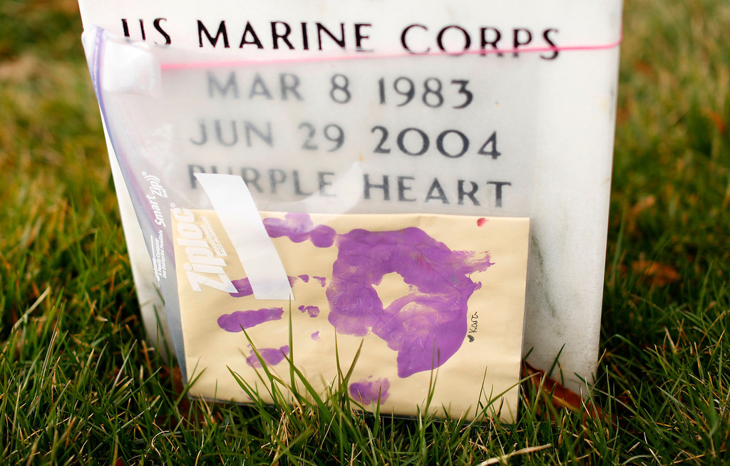 . A hand print, kept safe inside a Ziploc bag, adorns a headstone in Section 60 at Arlington National Cemetery in Virginia, March 13, 2013. Section 60 contains graves of soldiers from the wars in Iraq and Afghanistan. Picture taken March 13, 2013. REUTERS/Kevin Lamarque