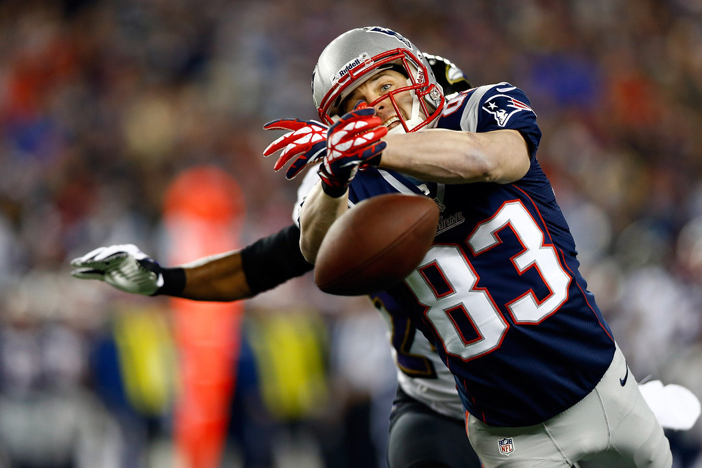 . Wes Welker #83 of the New England Patriots misses a ball thrown by Tom Brady #12 against the Baltimore Ravens in the first quarter during the 2013 AFC Championship game at Gillette Stadium on January 20, 2013 in Foxboro, Massachusetts.  (Photo by Jared Wickerham/Getty Images)