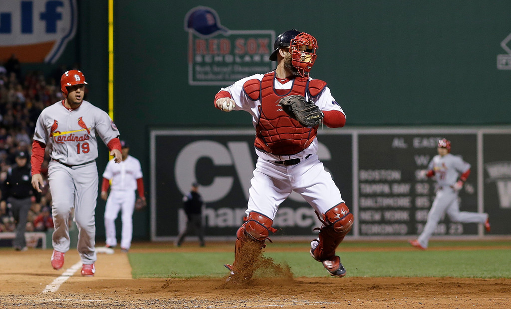 . St. Louis Cardinals\' Jon Jay (19) watches as Boston Red Sox catcher David Ross turns a double play on a ball hit by David Freese during the fourth inning of Game 1 of baseball\'s World Series Wednesday, Oct. 23, 2013, in Boston. (AP Photo/Matt Slocum)
