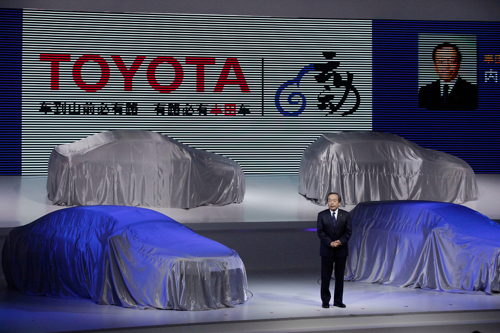 . Toyota Motor Corp. Vice Chairman Takeshi Uchiyamada delivers a speech before unveiling the company\'s new cars at the Shanghai International Automobile Industry Exhibition (AUTO Shanghai) media day in Shanghai, China Saturday, April 20, 2013. (AP Photo/Eugene Hoshiko)