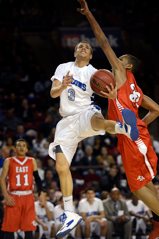 . DENVER, CO. - FEBRUARY 09: Evan Motlong (3) of Highlands Ranch drives to the basket on Tyre Robinson (32) of East February 9, 2012 at Magness Arena.  East defeated Highlands Ranch 73 - 54. (Photo By John Leyba/The Denver Post)