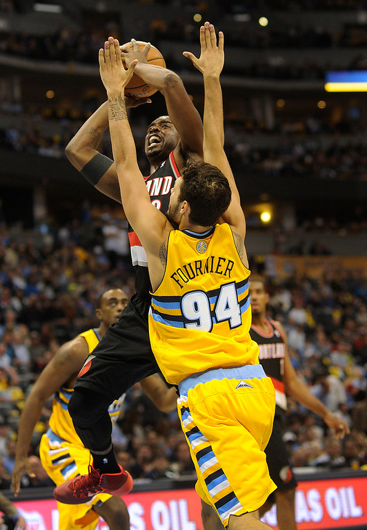 . DENVER, CO. - NOVEMBER 1:  Portland guard Wesley Mathews (2) put up a shot over Denver defender Evan Fournier (94) in the second half. The Denver Nuggets were defeated by the Portland Trail Blazers 113-98 Friday night, November 1, 2013 at the Pepsi Center.  The Nuggets are winless after two games. Photo By Karl Gehring/The Denver Post