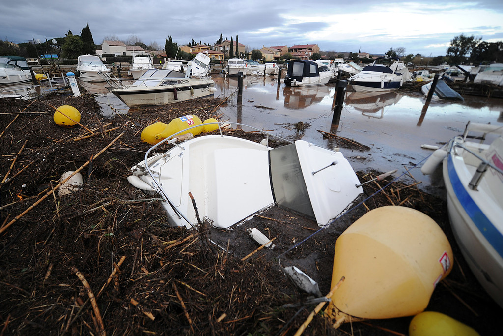 """. Boats and debris are washed up in the harbor of La Londe-les-Maures, southeastern France. River levels were receding early today in southeastern France after \""""historic\"""" floods left two people dead and more than 150 were airlifted to safety. A third man disappeared while out on his boat and 4,000 homes have been left without power after the deluge in the department of Var, they said. Local official Laurent Cayrel said one of the victims, a 73-year-old man, died in his basement, while the other was swept away in his car.  AFP PHOTO / BORIS HORVATBORIS HORVAT/AFP/Getty Images"""