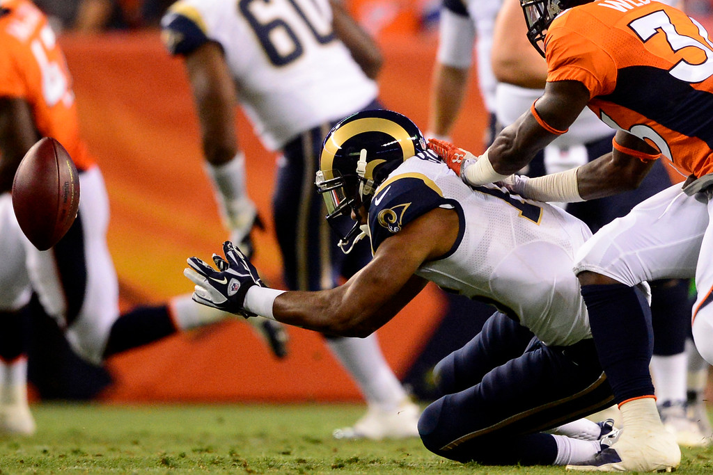 . DENVER, CO - AUGUST 24: Emory Blake (16) of the St. Louis Rams cannot haul in a pass as Kayvon Webster (36) of the Denver Broncos of the Denver Broncos defends during the second half of action of an NFL preseason game at Sports Authority Field at Mile High on August 24, 2013. This is the third game of the preseason for the Broncos. (Photo by AAron Ontiveroz/The Denver Post)