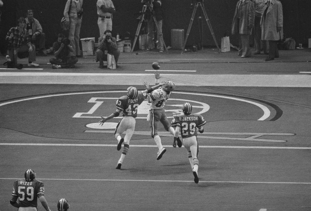 . Despite the effort of Denver defensive back Steve Foley (43), wide receiver Golden Richards of Dallas hauls in a touchdown pass from Robert Newhouse in Super Bowl XII in New Orleans. (AP Photo)