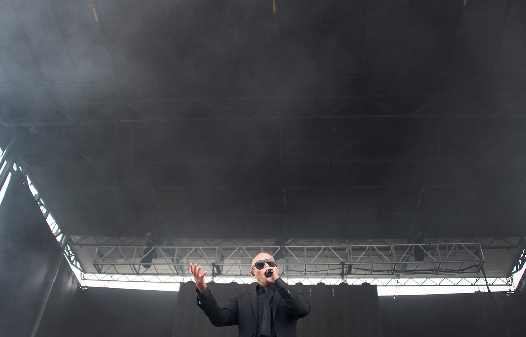 . Hip-hop performer Pitbull sings during a show prior to the 138th running of the Preakness Stakes at Pimlico Race Course on May 18, 2013 in Baltimore, Maryland. JIM WATSON/AFP/Getty Images