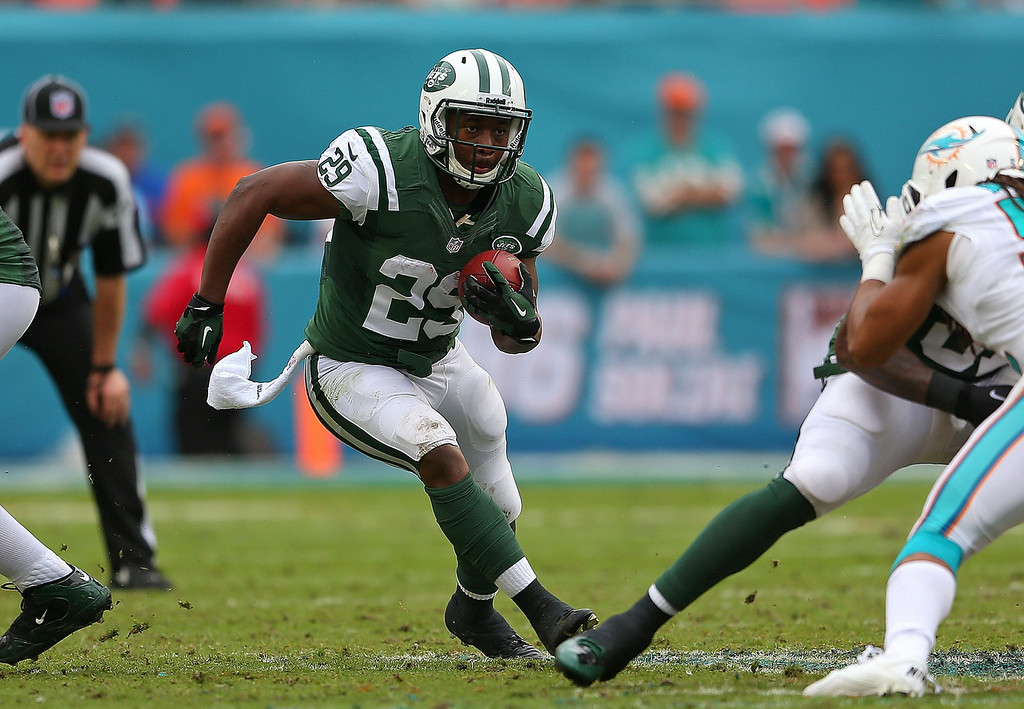. Bilal Powell #29 of the New York Jets rushes during a game against the Miami Dolphins at Sun Life Stadium on December 29, 2013 in Miami Gardens, Florida.  (Photo by Mike Ehrmann/Getty Images)