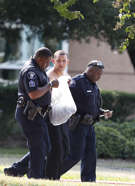 . Spring independent School District Police take a person into custody on the grounds of Spring High School September 4, 2013 in Spring, Texas.  (Photo by Thomas B. Shea/Getty Images)