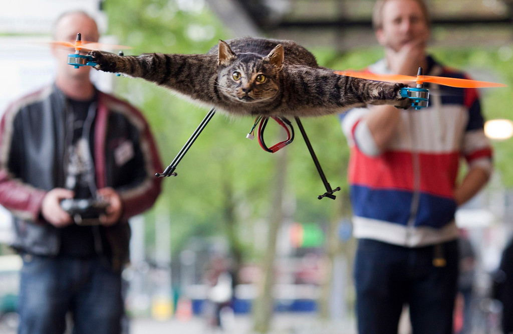 . The Orvillecopter by Dutch artist Bart Jansen (R) flies in central Amsterdam as part of the KunstRAI art festival June 3, 2012. Jansen said the Orvillecopter is part of a visual art project which pays tribute to his cat Orville, by making it fly after it was killed by a car. He built the Orvillecopter together with radio control helicopter flyer Arjen Beltman (L) . REUTERS/Cris Toala Olivares