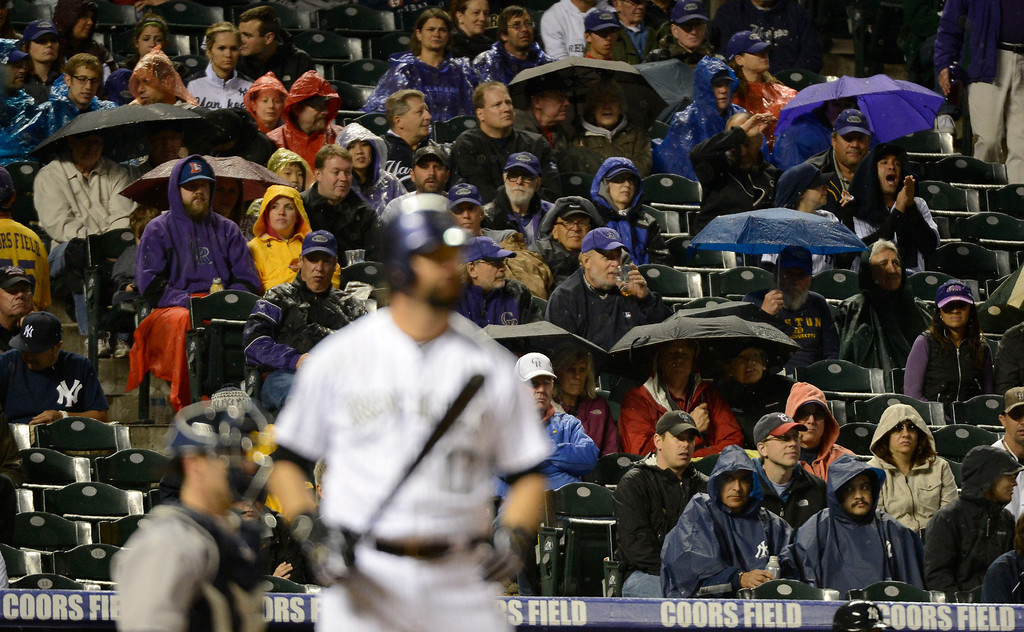 . DENVER, CO. - MAY 07: The rain started to come down in the fourth inning during the Colorado Rockies New York Yankees game May 7, 2013 at Coors Field. (Photo By John Leyba/The Denver Post)